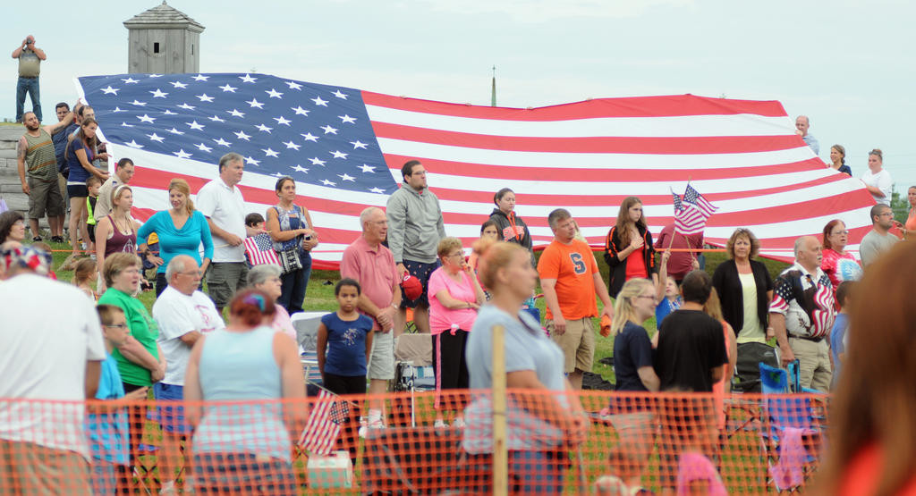 The American Flag being held during the singing of the National Anthem.  (Sentinel photo by Makenzi Enos)