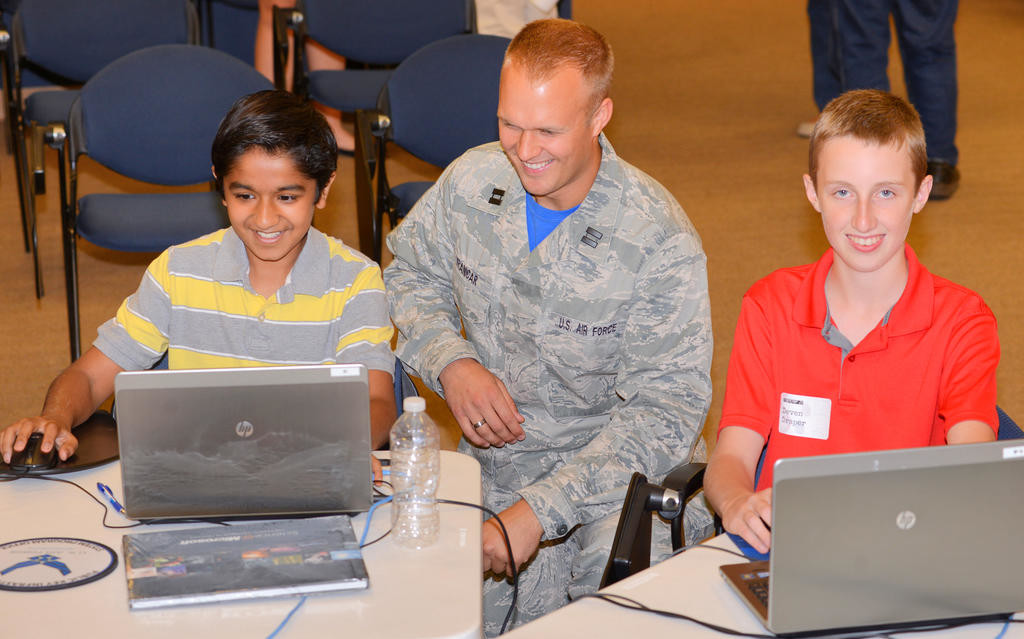 SPECIAL SCREENING — Harshil Thaker, left, of Utica and Deven Draper, right, of Deerfield, work with Air Force Capt. Trevor Vranicar during a Cyber Camp 2.0 activity Friday at the Griffiss Institute. The camp, which was from Monday through Friday, is an Air Force Research Laboratory STEM (science, technology, engineering, math) outreach program with an objective that was to prepare students to remotely defend a website that was under attack. The camp was geared for grades 8-12.The institute will host four other STEM-related camps this summer.  (Sentinel photo by John Clifford