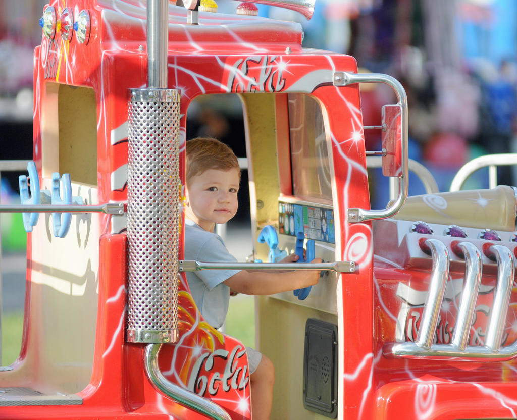 Owen Kaido 2 son of Elizabeth Kaido of Lake Delta steers a truck cart on a childrens train ride at the fair Tuesday evening.  (Sentinel photo by Makenzi Enos)