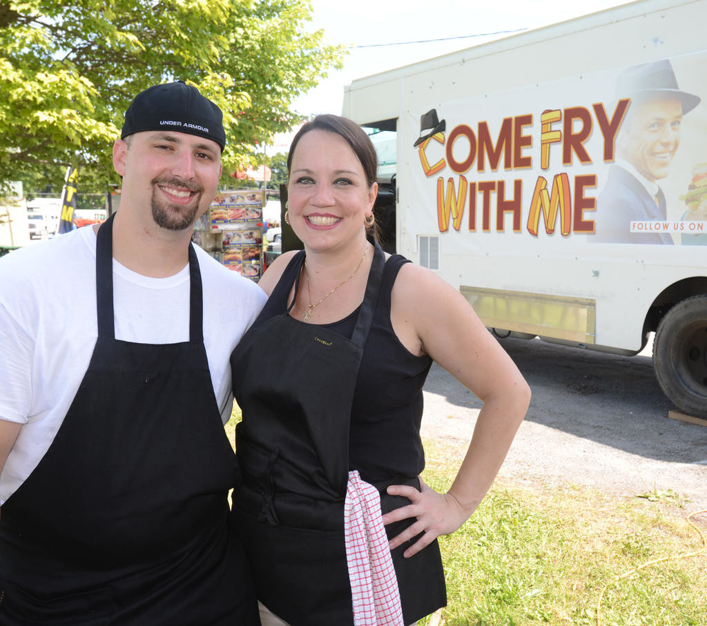 Ron and Anne Colangelo with their new food vending truck at the Boonville Oneida County Fair. This was their very first day of being in business.  (Sentinel photo by John Clifford