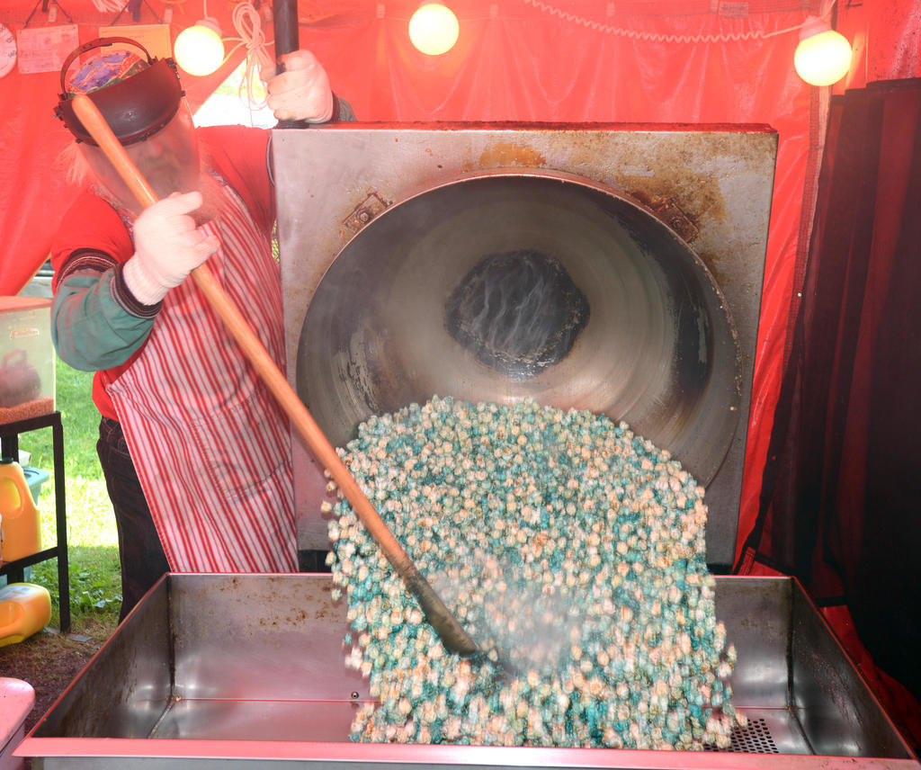 Vernon Phillips of Kris Kringle Kettle Korn from Watertown dumps a new batch of kettle korn at the Boonville Oneida County Fair.  (Sentinel photo by John Clifford