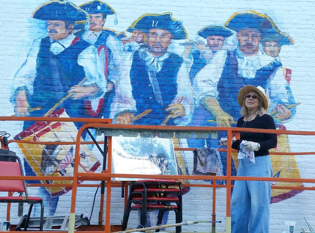 COMING TO LIFE — Members of the Camden Continentals Fife and Drum Corps, and the ancestors who started their legacy 164 years ago, begin to take shape on the VFW wall by the hands of Jane Grace Taylor. (Photo submitted)