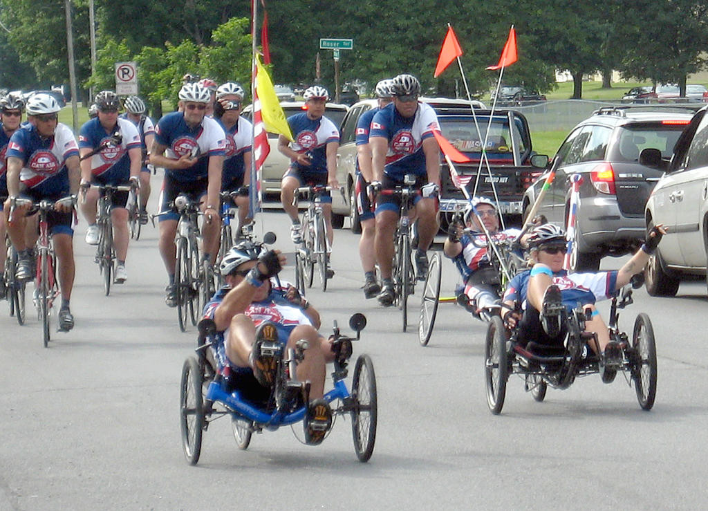 VETERANS RIDE — Members of the CanAm Veterans' Challenge ride their way down West Chestnut Street toward the Wingate Hotel at Griffiss Business and Technology Park for an overnight stay Monday.  (Sentinel photo by Nicole A. Elliott)