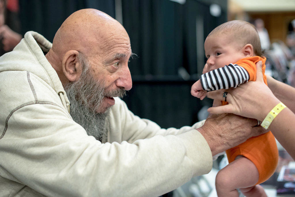 "GOOD WITH KIDS — Horror movie icon Sid Haig, famous for such films as ""House of 1,000 Corpses"" and ""The Devil's Rejects"", poses with a tiny horror movie fan at last year's Scare-A-Con at the Turning Stone Resort and Casino."