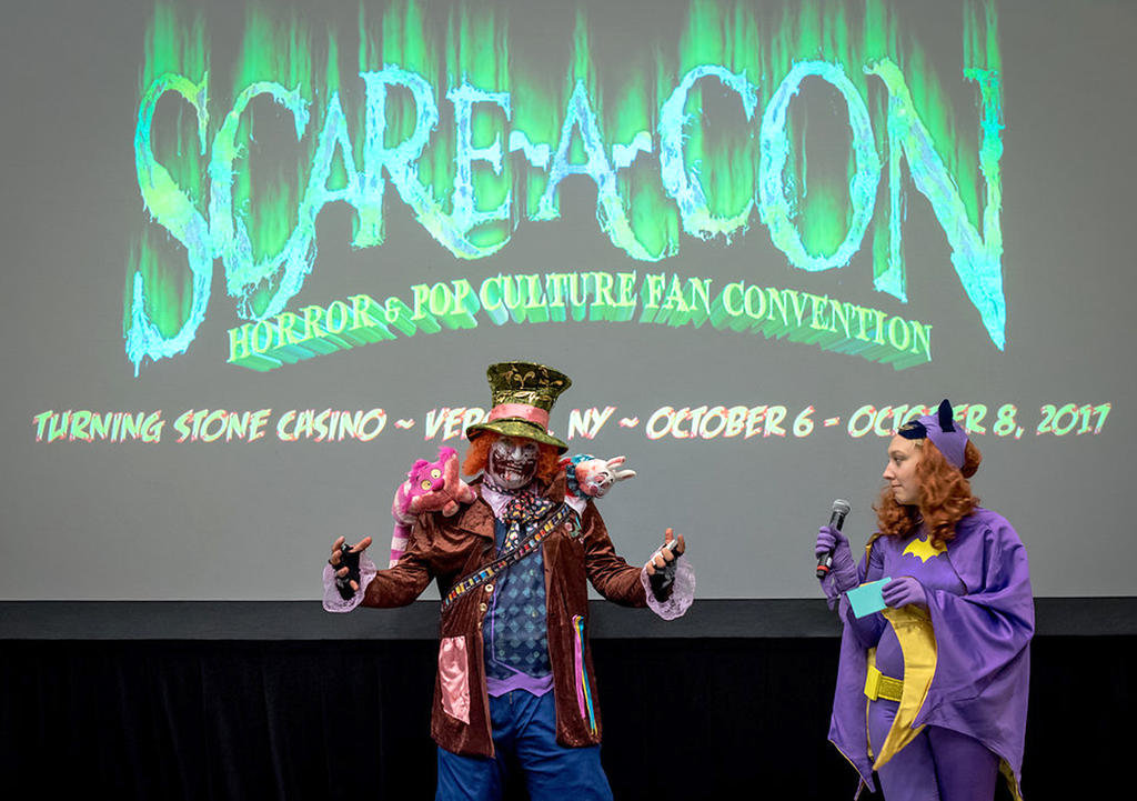 COSTUME CONTEST — Batgirl welcomes a scary zombie clown to Scare-A-Con's annual costume contest.