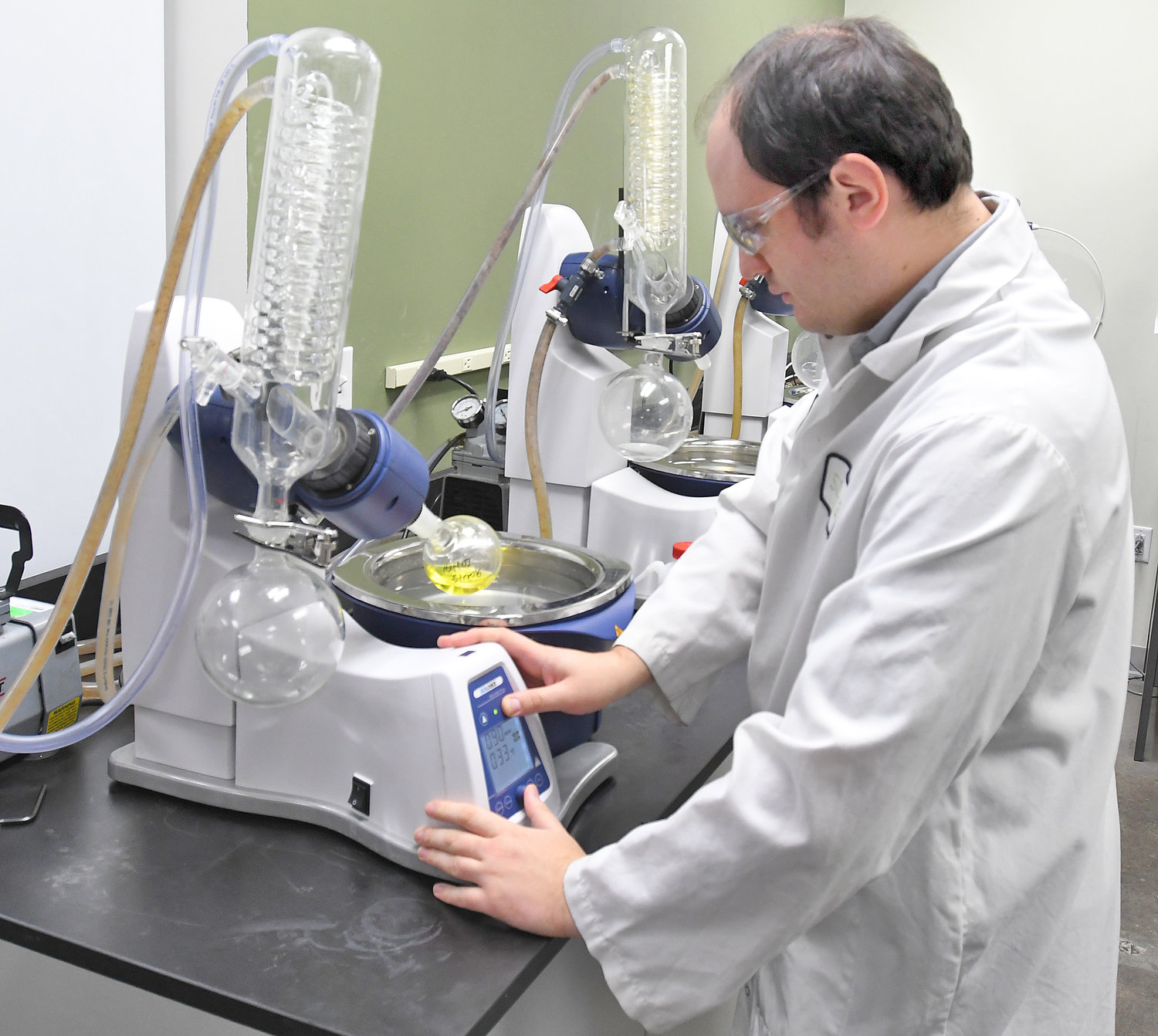 TESTING UNDER WAY — Derek Treonze, a lab technician at Sovena USA Inc., tests a sample of avocado oil for purity in the company's lab at its Griffiss business park facility. Additional photos online at www.romesentinel.com.