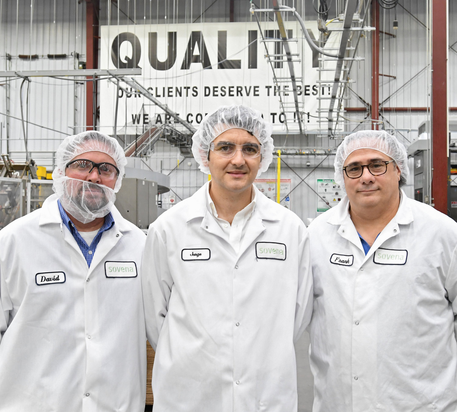 COMPANY LEADERS, QUALITY FOCUS — Inside the Sovena USA plant at Griffiss business park are, from left: Director of Human Resources David Winberg; Managing Director Jorge Pena; Vice President of Operations Frank J. Talarico Jr. They are wearing coats and hair nets as part of food safety procedures.