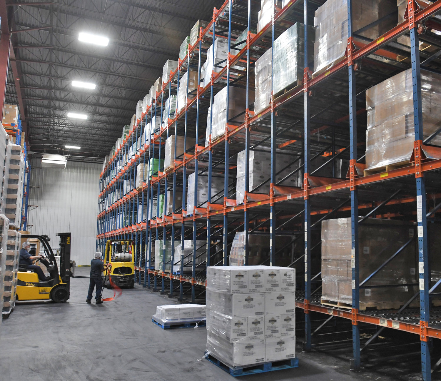ORGANIZING THE INVENTORY — Various olive oil and related products are assembled in the warehouse at Sovena USA's Griffiss business park facility before being shipped out.