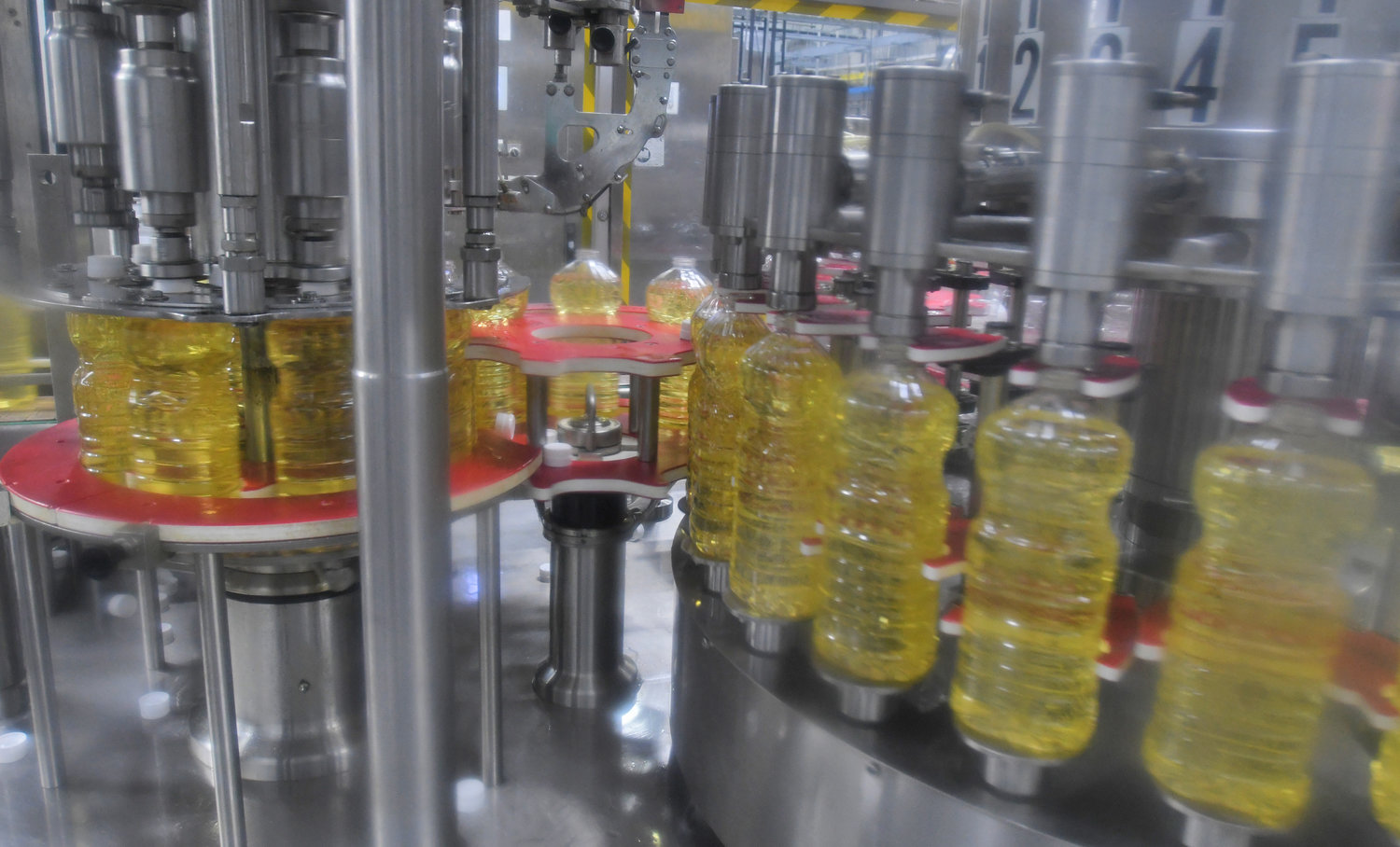 FILL THEM UP — Bottles are filled with oil at Sovena USA's plant at Griffiss park. It ships olive oil and various related products.