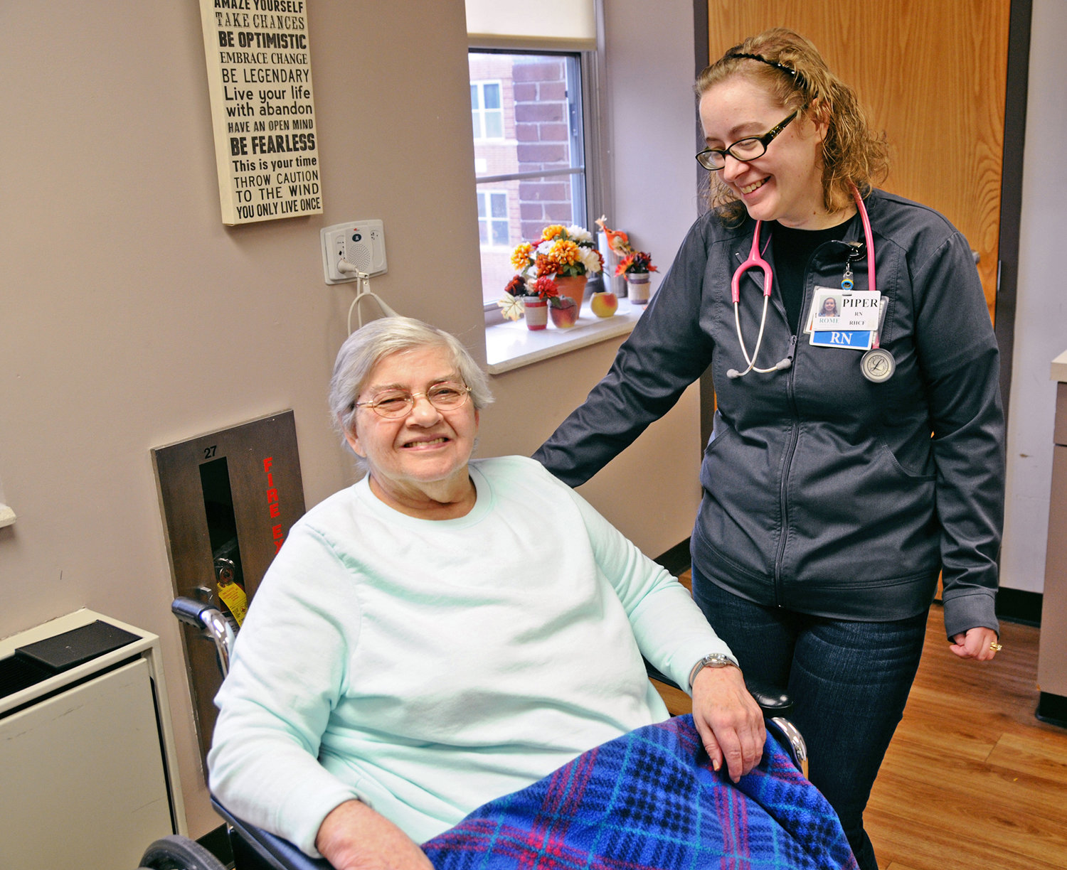 FIVE STAR CARE — Rome Memorial Hospital Residential Health Care (RHCF) resident Alma Jones shares a laugh with Piper Reese, RN, in the resident's activity room. The RHCF is the only skilled nursing facility in Oneida County to earn the highest 5-star rating from the Centers for Medicare & Medicaid Services (CMS) Nursing Home Compare.