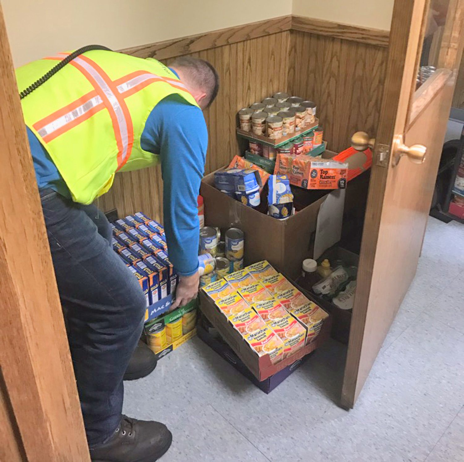 PLENTY TO EAT — Donated food items for the Feed Our Vets organization are gathered at Worthington Industries' Rome site, where employees participated in a drive.