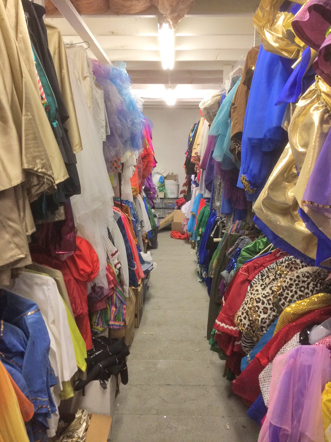 "70-YEAR COLLECTION — In the ""third floor"" of Clinton Arena, a room stores 70 years worth of figure skating costumes that are continually re-used and up-cycled by the organization."
