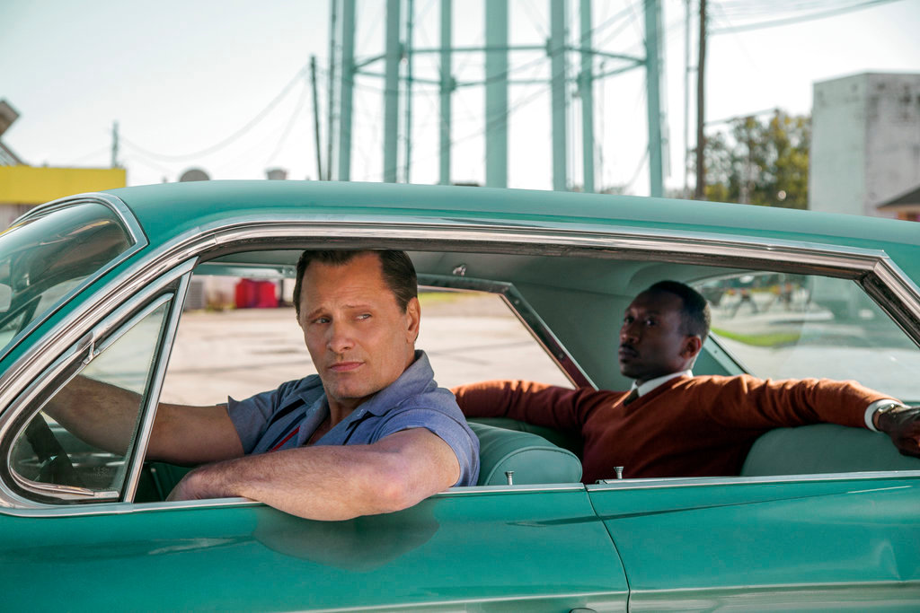 "This image released by Universal Pictures shows Viggo Mortensen, left, and Mahershala Ali in a scene from ""Green Book."" On Thursday, Dec. 6, 2018, the film was nominated for a Golden Globe award for best motion picture musical or comedy. The 76th Golden Globe Awards will be held on Sunday, Jan. 6. (Patti Perret/Universal Pictures via AP)"