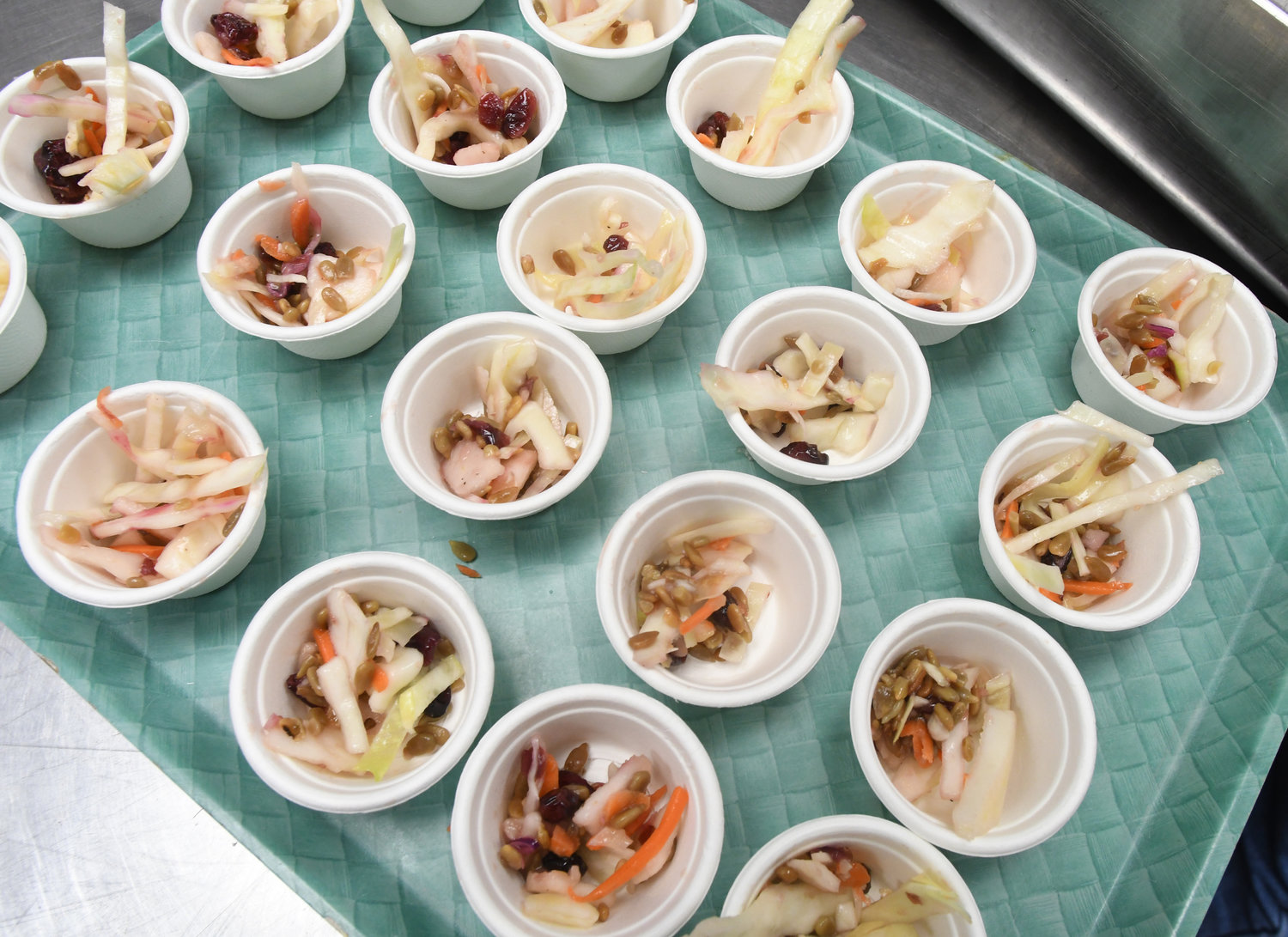 EATING HEALTHY — Cups of Asian Cabbage Slaw are ready to be served to children at Clinton Elementary School.