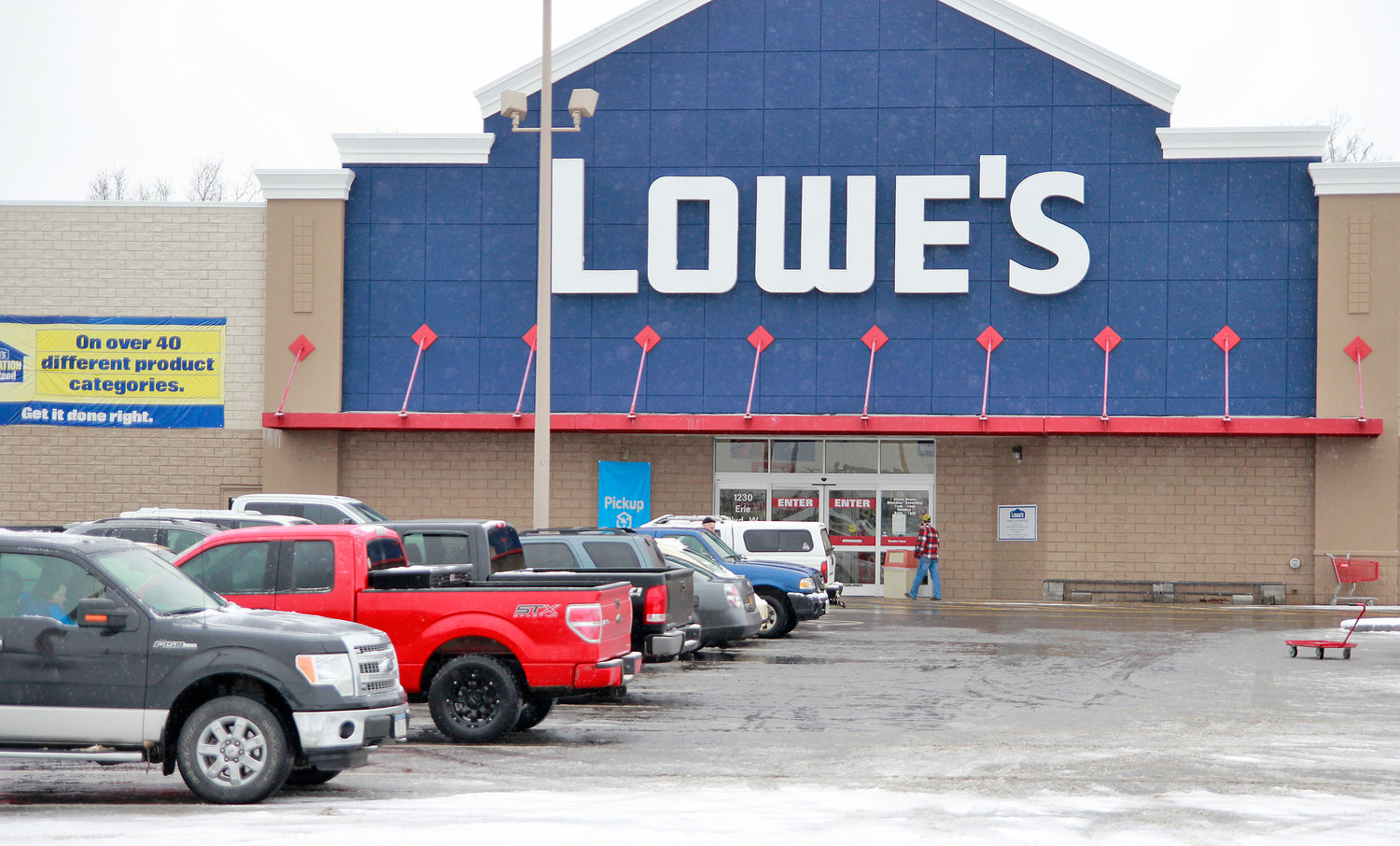 BUSINESS AS USUAL — Post-holiday shoppers kept business brisk at the Lowe's store at 1230 Erie Blvd. W. on Wednesday. Although the retailer is closing 51 stores in the U.S. and Canada, no local stores were impacted according to media releases on the company's website.