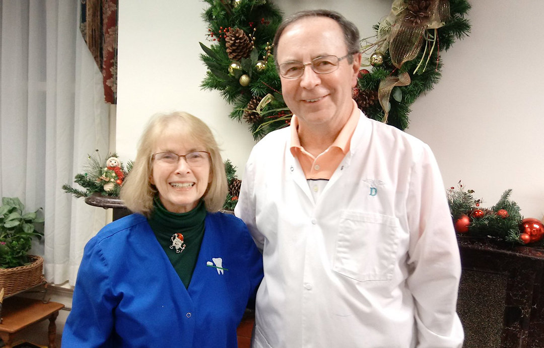 RETIRING — Alma Ingalls, dental assistant who is retiring after 50 years, and Dr. John Menard, dentist.