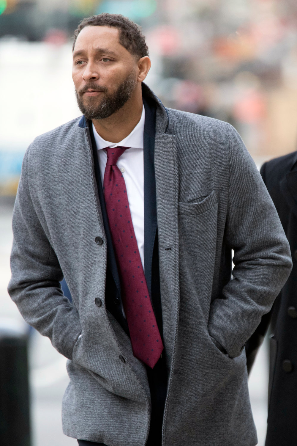 GUILTY PLEA — Former Southern California assistant basketball coach and Syracuse player Tony Bland arrives at federal court in New York on Wednesday. Bland entered a guilty pleas in a criminal case in which prosecutors said bribes were paid to steer top athletes to certain schools.
