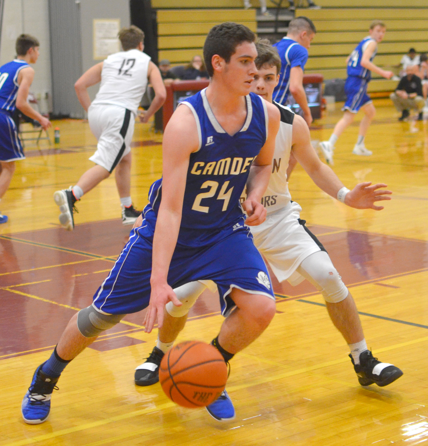 CLOSE DEFENSE — Camden's Joshua Leos tries to get past Clinton defender Tanner Deveans during Monday night's game in Clinton. The host Warriors scored a 50-33 victory. Game details were unavailable.