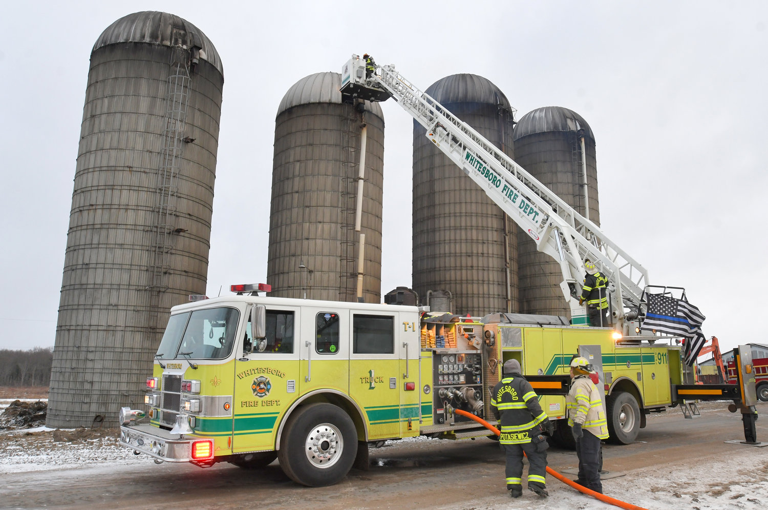 SILO FIRE — A ladder truck was needed to get hose lines down inside a silo fire at the Terry Jones Farm on Whittaker Road in Trenton this morning. One of fire silos started burning on the inside, less than a week after the Jones family lost nearly 200 cows in a barn fire.