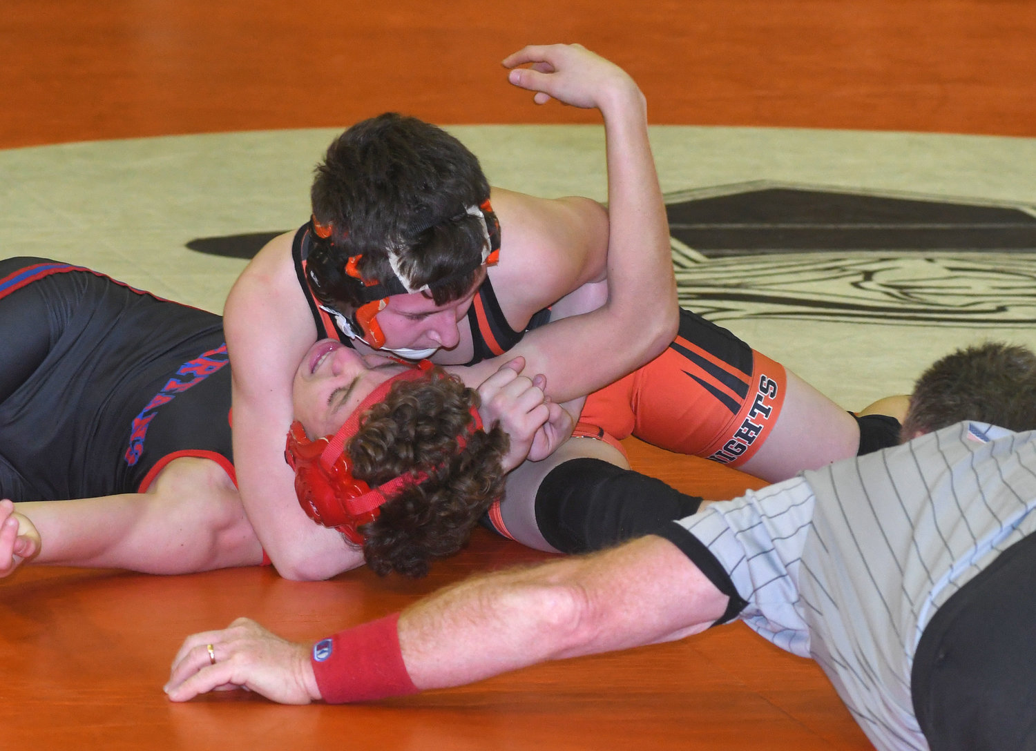 DOWN FOR THE COUNT — Rome Free Academy's Ashton Thompson gets the pin of New Hartford's Osciano Swartz with referee Terry Kavanaugh officiating during Wednesday's match in Rome. Thompson won by pinfall as RFA went on to score a 58-30 win.