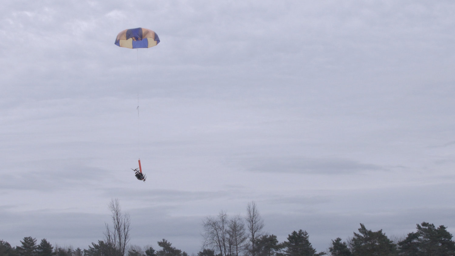 DRONE CHUTE — A drone equipped with a parachute system made by Indemnis of Anchorage, Alaska, shown during a test in December at Griffiss International Airport's drone test site operated by the Northeast UAS Airspace Integration Research Alliance.