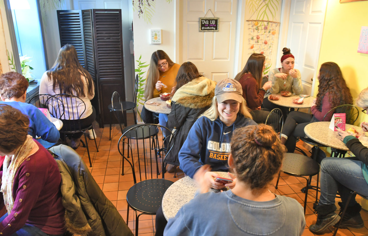 POPULAR SPOT — Happy customers enjoy their Soul Bowls at the cafe by the same name in Clinton.