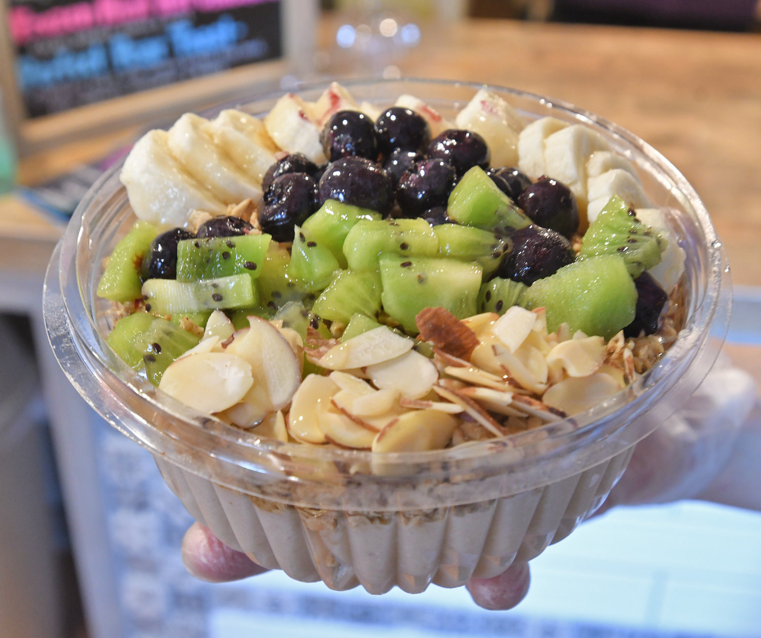 "SUPER FOODS — A Soul Bowl is ready to go, featuring blueberries, kiwi, bananas and almonds.  Owner Jenna Stanton offers bowls of ""super fruits"" like acai and dragon fruit, mixed with other nutrient-filled ingredients, that are ""meals, not desserts,"" she said."