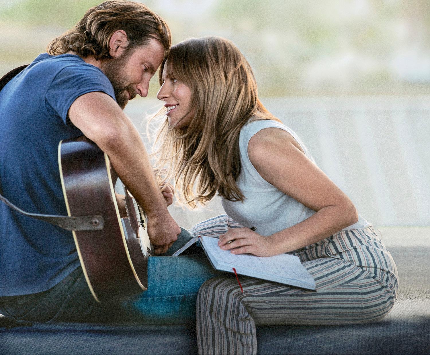 "REMAKE — Bradley Cooper, left, and Lady Gaga in a scene from ""A Star is Born."""