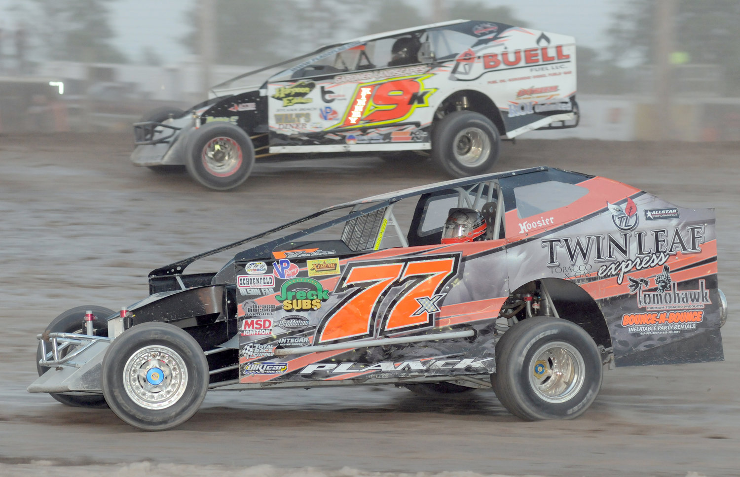 BACK IN THE SEAT — Dale Planck, 77x, races Oneida's Paul Kinney during a July 11, 2011 race at Utica-Rome Speedway. Planck's last full racing season was in 2013 but is set to race weekly at Fulton Speedway in 2019.