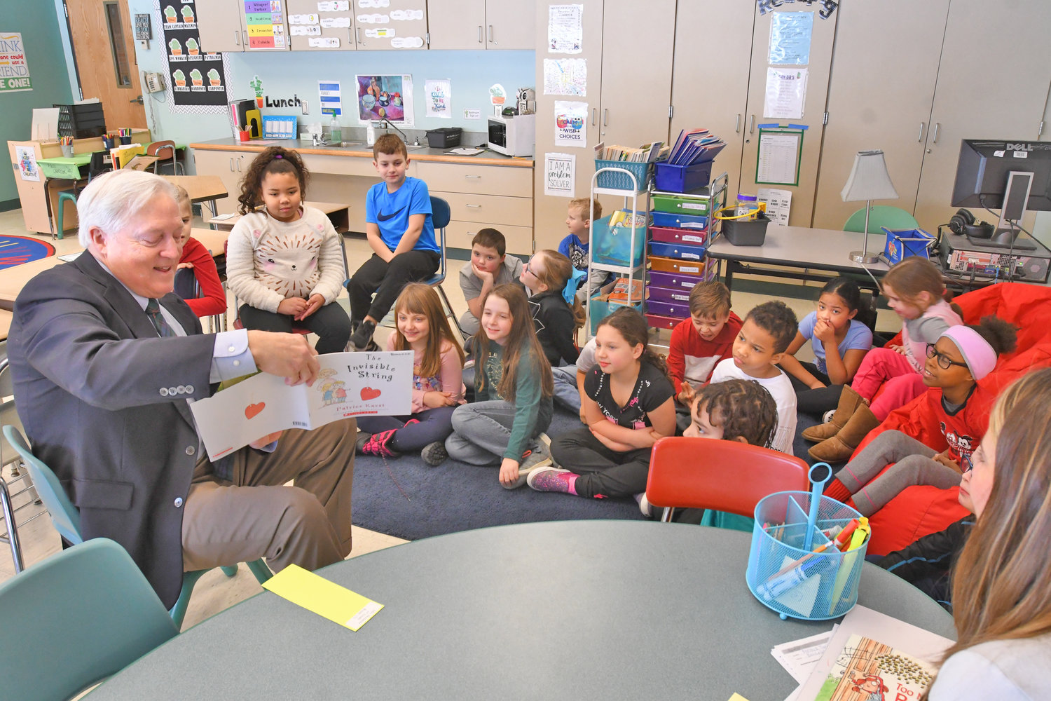 "STORYTIME AT GANSEVOORT — Rome Daily Sentinel Owner and Publisher Stephen B. Waters reads ""The Invisible String"" by Patrice Karst to a third-grade class at Gansevoort Elementary School this morning. Every class at the school took part in the ""Community Readers Day"" that was organized by Gansevoort librarian Keri Citriniti in conjunction with the overall ""World Read Aloud Day"" observance. She said there were 18 readers from the community overall."