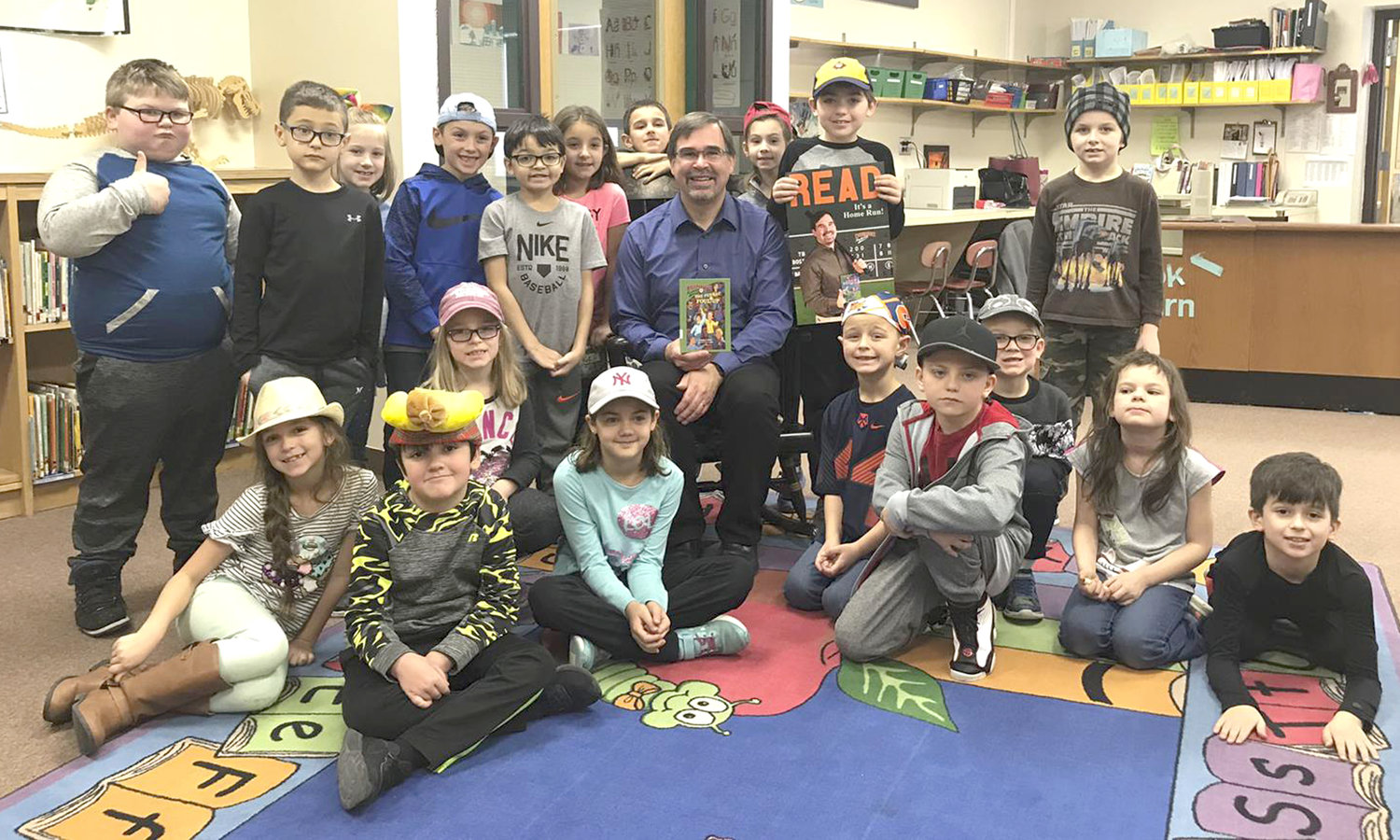 SPORTS MYSTERIES — Children's author David Kelly, center, recently visited and read his books to pupils at Westmoreland Elementary School.
