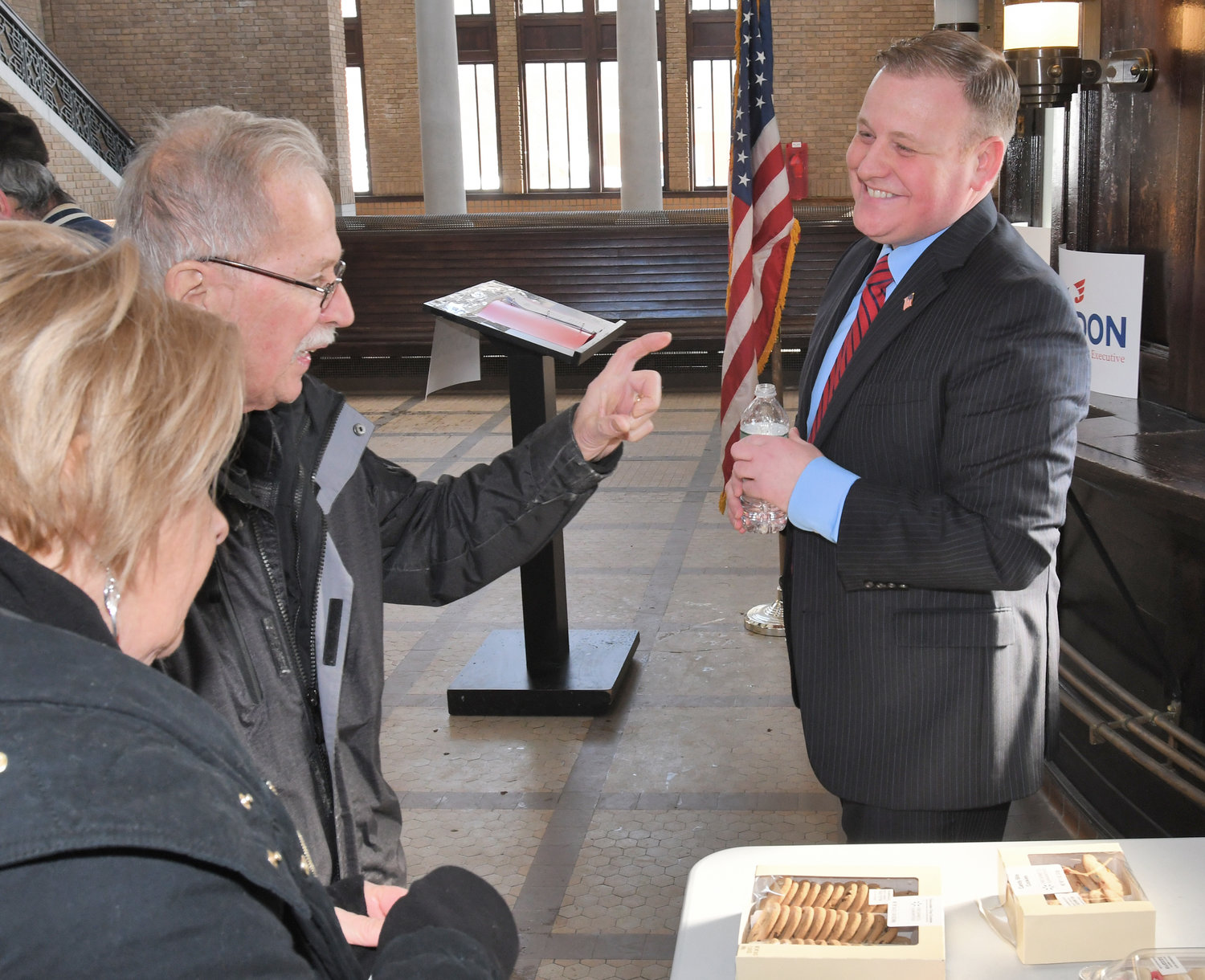 READY TO RUN — David Gordon, right, talks with uncle and aunt Dan and Candy Wisnoski just prior to making his announcement to run for Oneida County executive on Jan. 31 at the Rome Train Station on Martin Street. Gordon previously lost a hotly contested race for county clerk in  November.