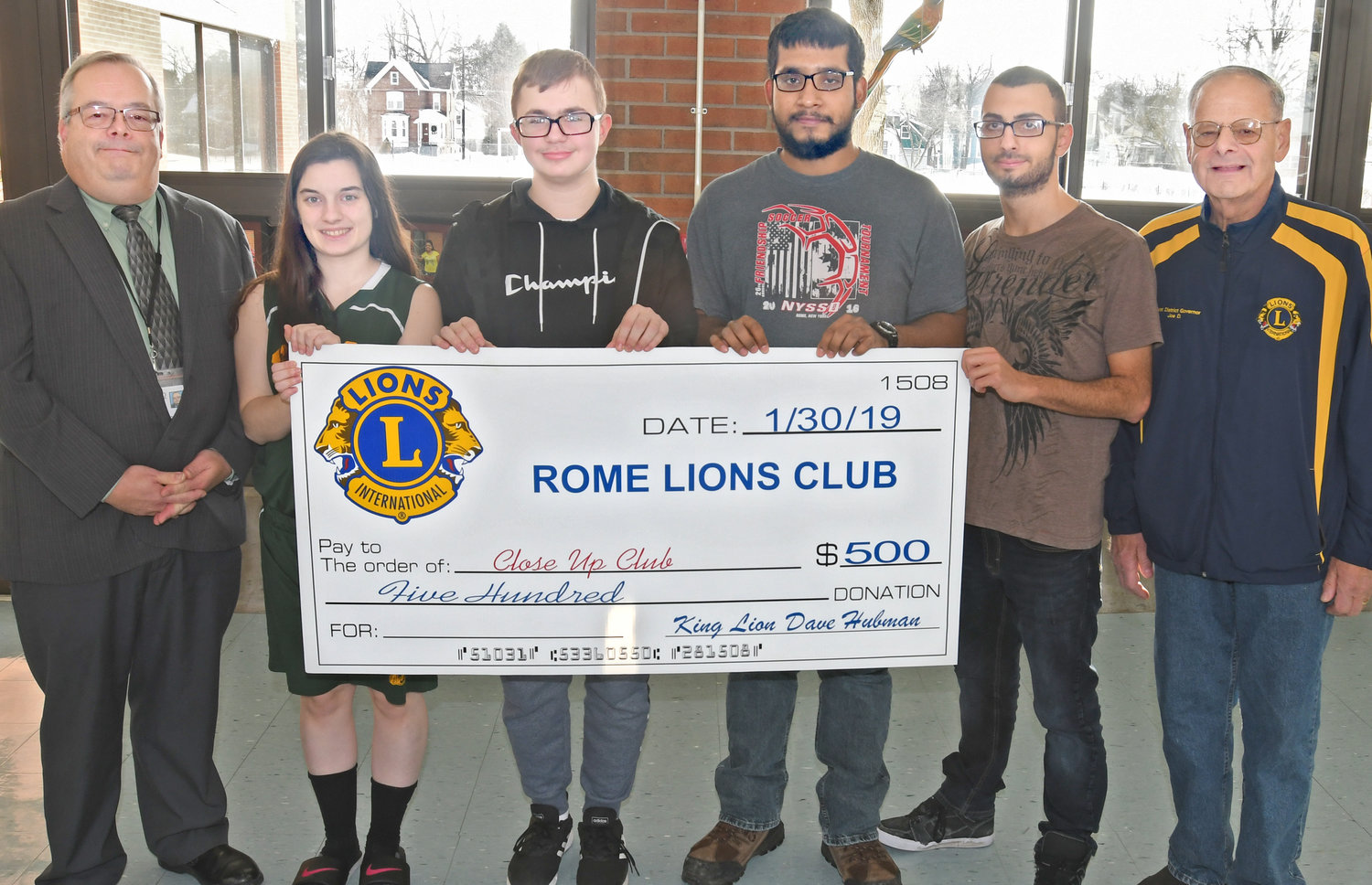 SUPPORT FOR JOURNEY — The Rome Lions Club presents students at the New York State School for the Deaf, 401 Turin St., with a donation of $500 to help support an educational trip by students to Washington, D.C.  From left: NYSSD Superintendent David Hubman; students Abigail Anzalone, of Unadilla; Arif Cajic, of Utica; Ka Dil, of Utica; Yousef Sawaqed, of  Poughkeepsie; and Joe DeFina, of the Rome Lions Club.