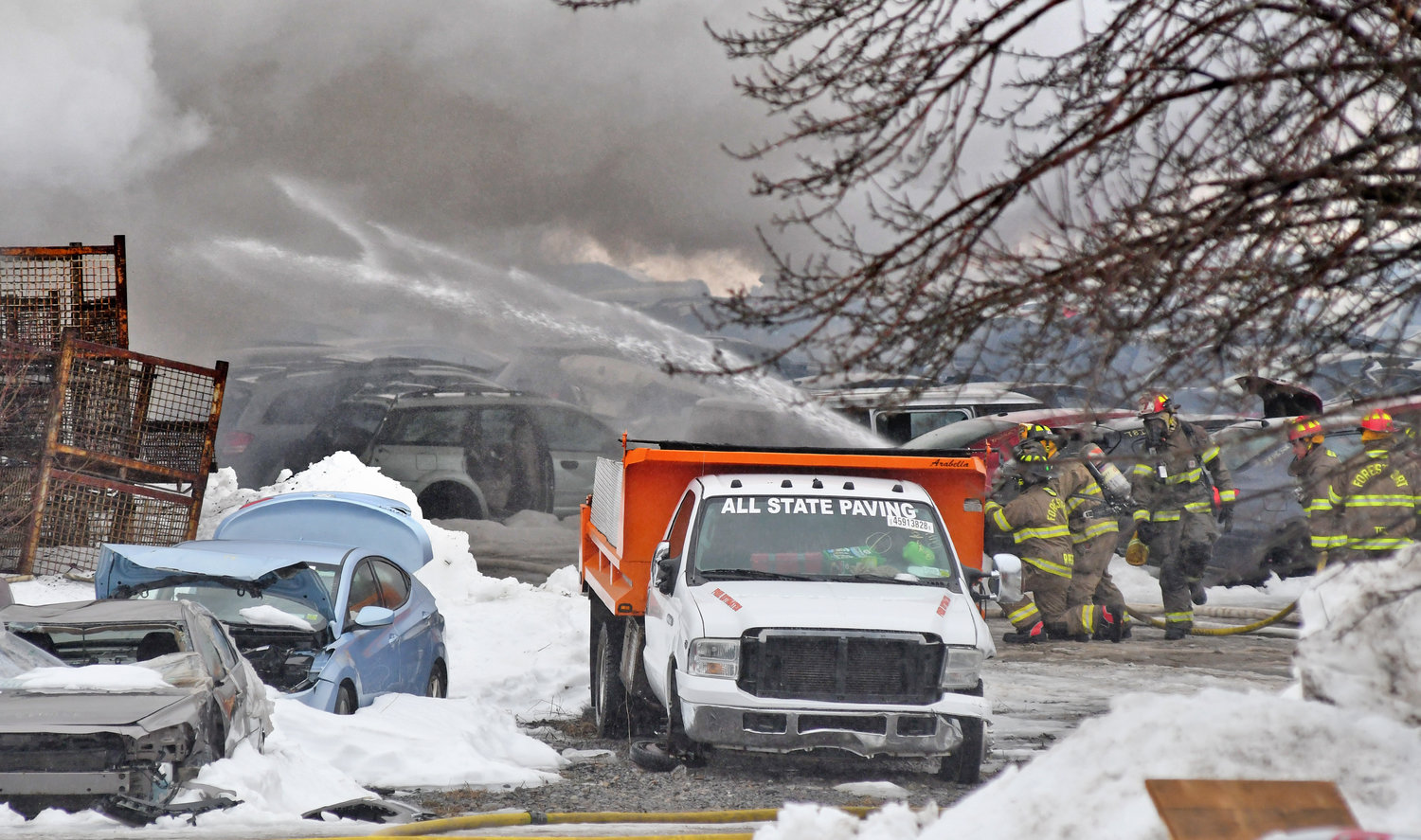 DEBRIS — Old, battered cars litter the scene of a large fire at Tolpa's Auto Parts on French Road in Steuben Wednesday afternoon. Forestport firefighters were some of several volunteer agencies dispatched to the scene. (Sentinel photo by John Clifford)