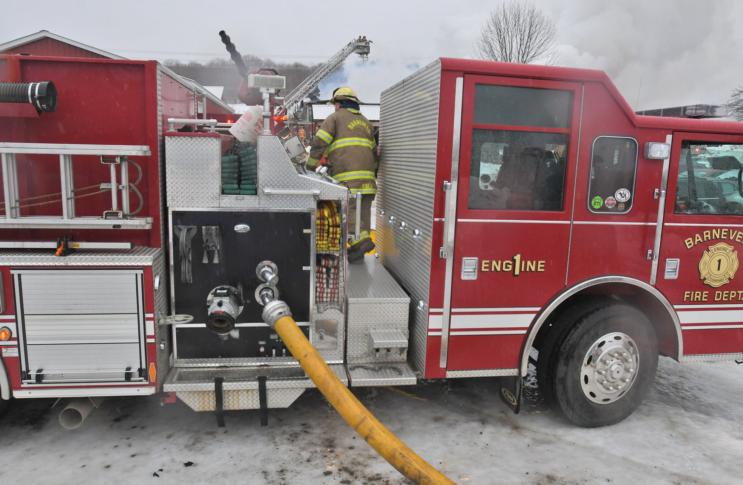 MULTIPLE CREWS — Barneveld was one of more than half a dozen volunteer fire departments helping out at the fire at Tolpa's Auto Parts off French Road in Steuben Wednesday afternoon.