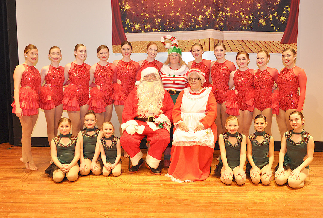 HOLIDAY SHOW — Members of Susan Hasty's School of Dance pose with Santa and Mrs. Claus at their holiday show at Rome Free Academy in December.  The event raised $3,100 for the American Cancer Society.