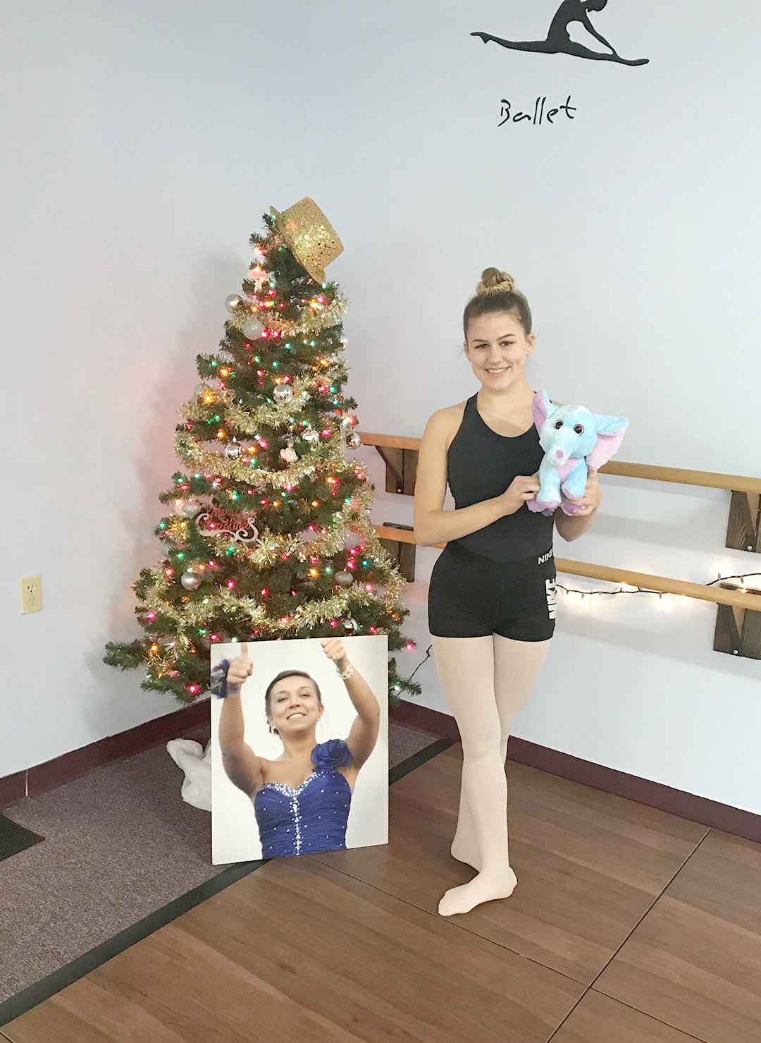 AWARD WINNING — The Most Improved Competitor Scholarship was awarded to Alexa Beaupre in the memory of former student Jillian Velardi, who was killed in an automobile accident. Here, Beaupre poses with a photo of Velardi next to the holiday tree.