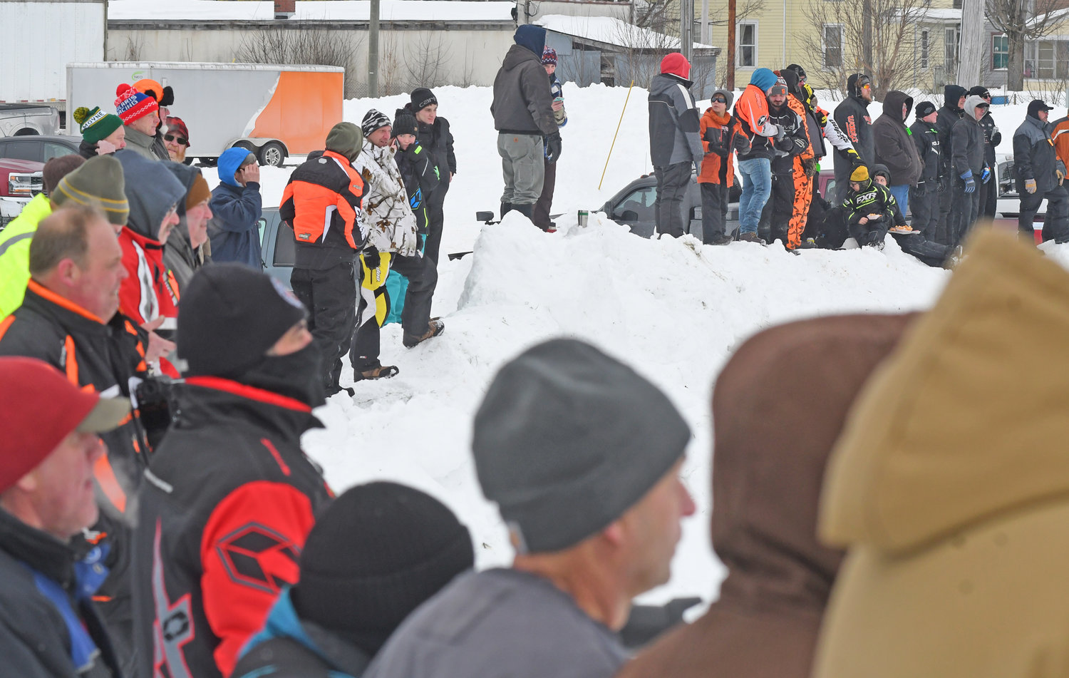 ALL REVVED UP — Race fans line the banks as they stand on the sidelines to watch the racing on Feb. 2 at the Boonville Snow Fest on Saturday. After several days of frigid weather, spectators were greeted by more seasonable temperatures both last Saturday and Sunday.