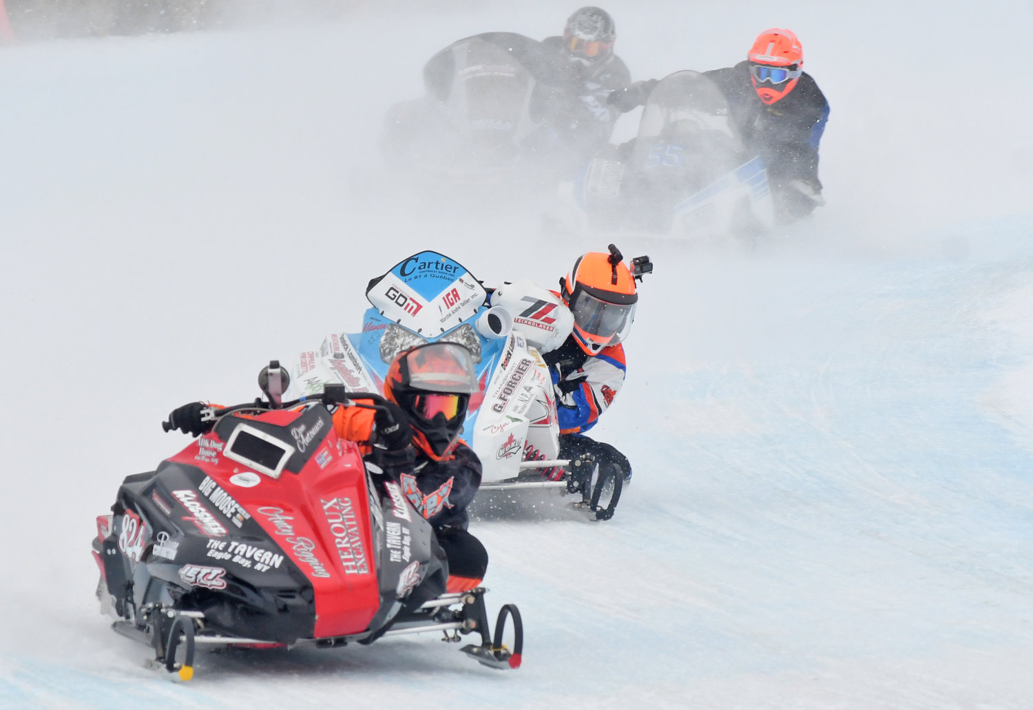 INTO THE TURN — Dominick Antonucci leads a group of sleds through turn four on Saturday at the Boonville Snow Festival. There were races for several levels of competitors at the Boonville Snow Festival over the weekend.