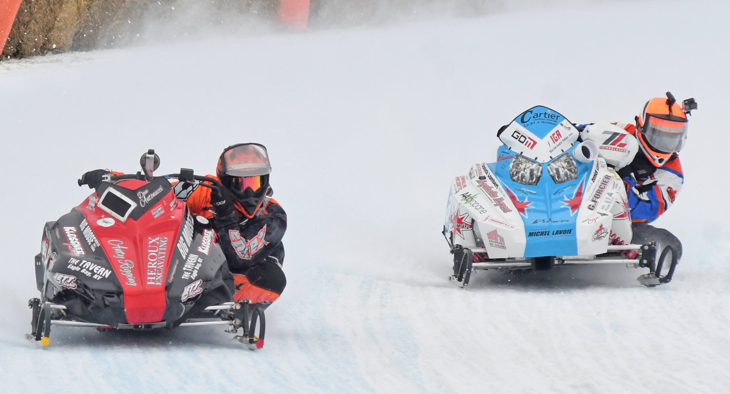 NECK-AND-NECK — Dominick Antonucci and Danick Lambert duke it out during a race on Feb. 2. Antonucci went on to win the race.