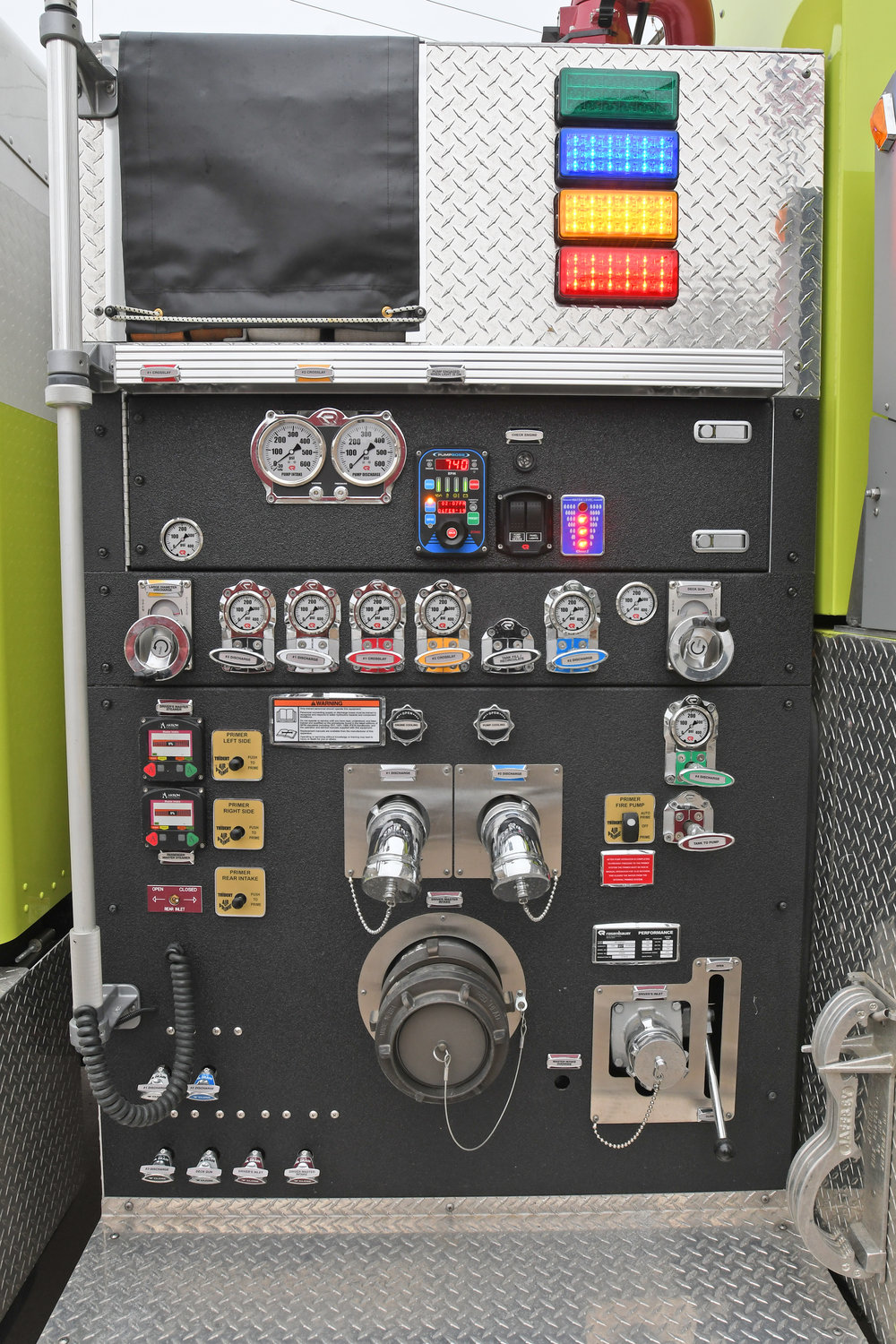 BELLS AND WHISTLES — The control panel on the side of the new tanker/pumper truck at the Oriskany Fire Department.