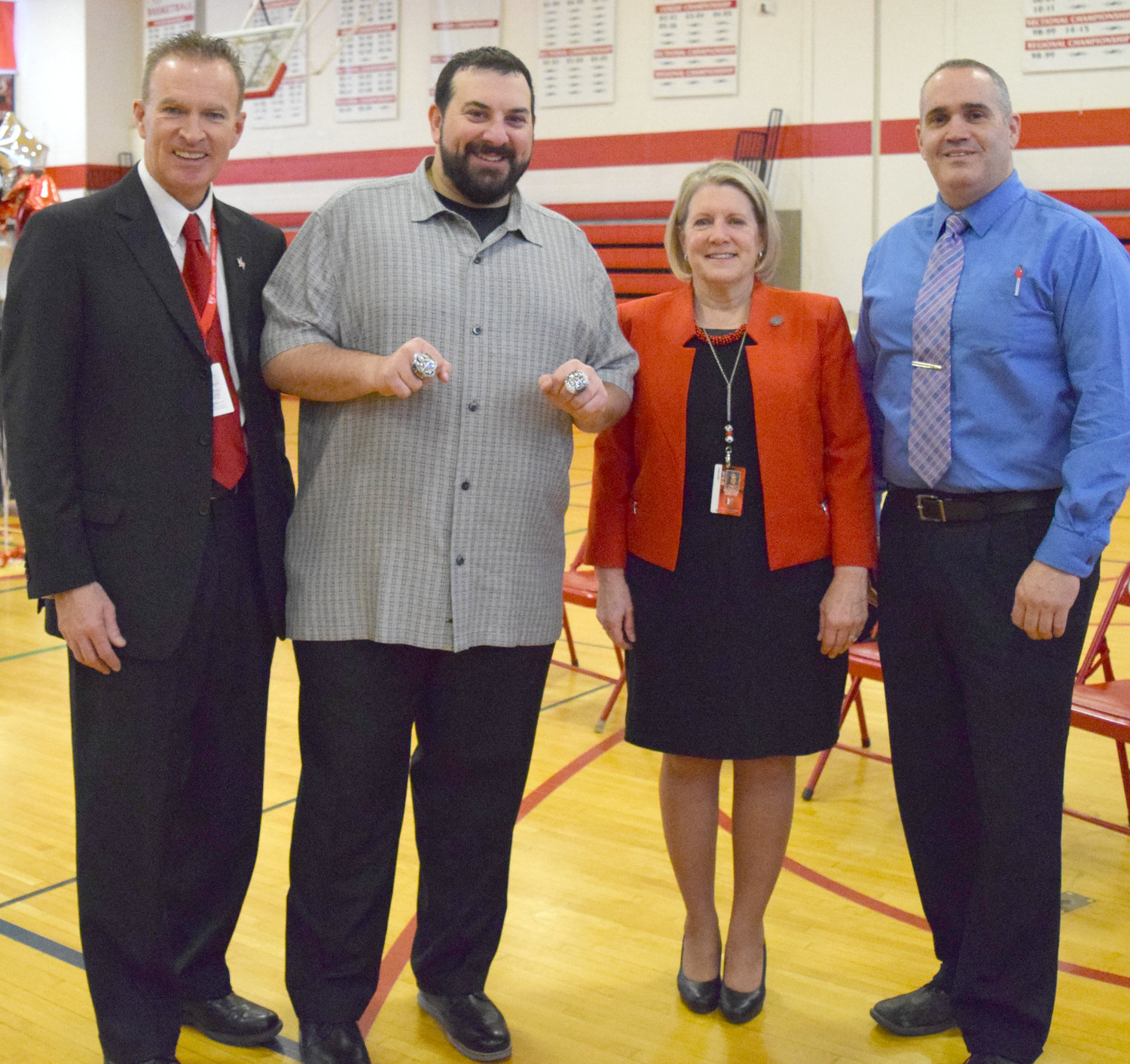 VVS CELEBRITY ALUMNUS VISIT — Matt Patricia, who won two Super Bowls as defensive coordinator of the New England Patriots and now is head coach of the Detroit Lions, shows off his rings during a visit Friday to his alma mater, Vernon-Verona-Sherrill High School. From left: Andy Brown, VVS school district assistant superintendent of curriculum, instruction and assessment; Patricia; VVS Superintendent Martha Group; Mark Wixson, VVS Assistant superintendent for finance and operations.