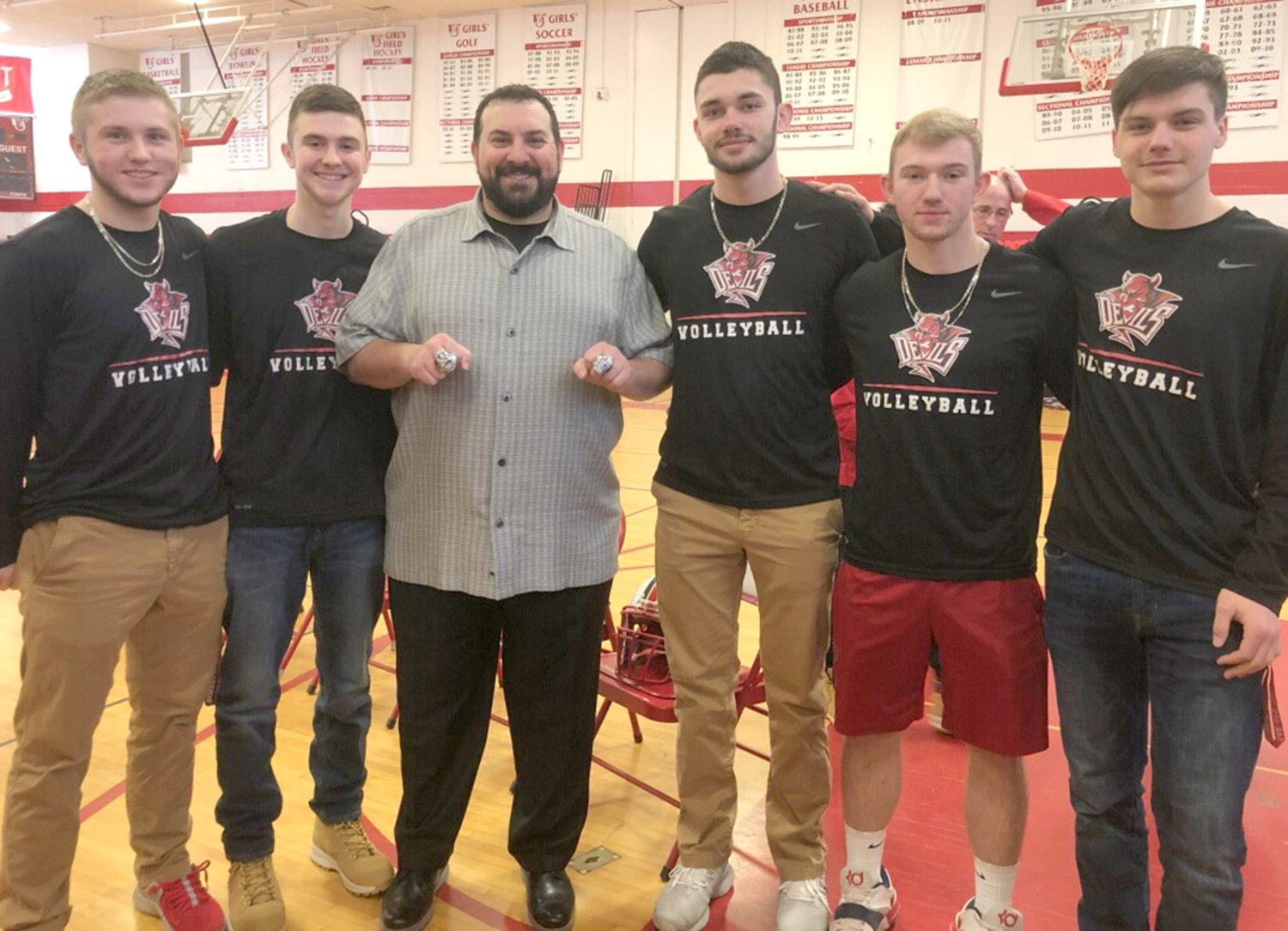 NFL COACH AT VVS — Detroit Lions pro football head coach Matt Patricia, third from left, visits his alma mater Vernon-Verona-Sherrill High School Friday morning. Patricia, who won two Super Bowls when he was defensive coordinator of the New England Patriots, shows off his rings. Among VVS students with him, from left: Ryan Shantal, Gavin Miller, Adam Durfee, Cole Smith and Eli Creedon.