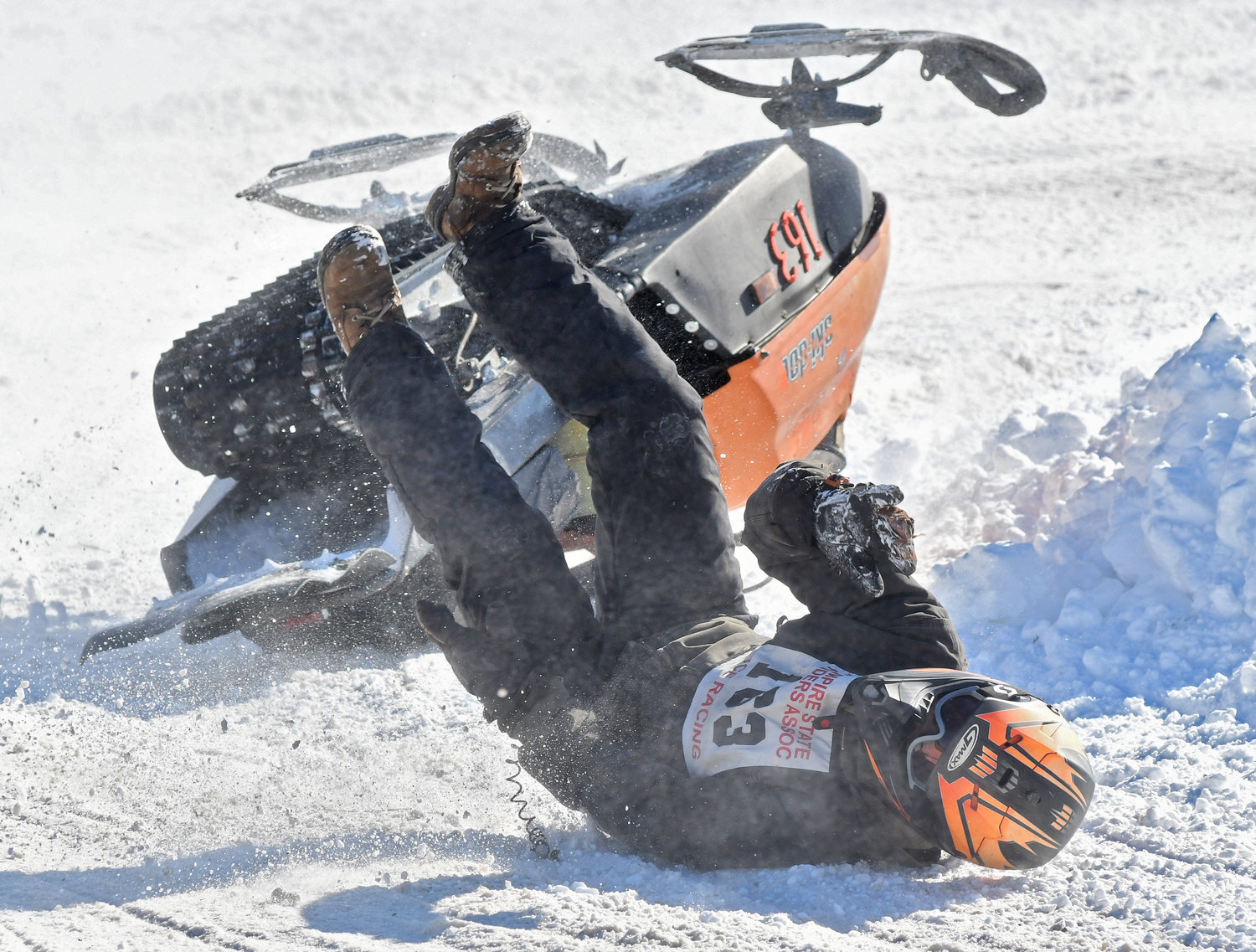 CRASH LANDING — Anthony Brownell from Tupper Lake lands after going upside down during the Old Dog Races in Taberg on Saturday afternoon. Snowmobilers from across the region gathered at the event to race vintage snowmobiles.