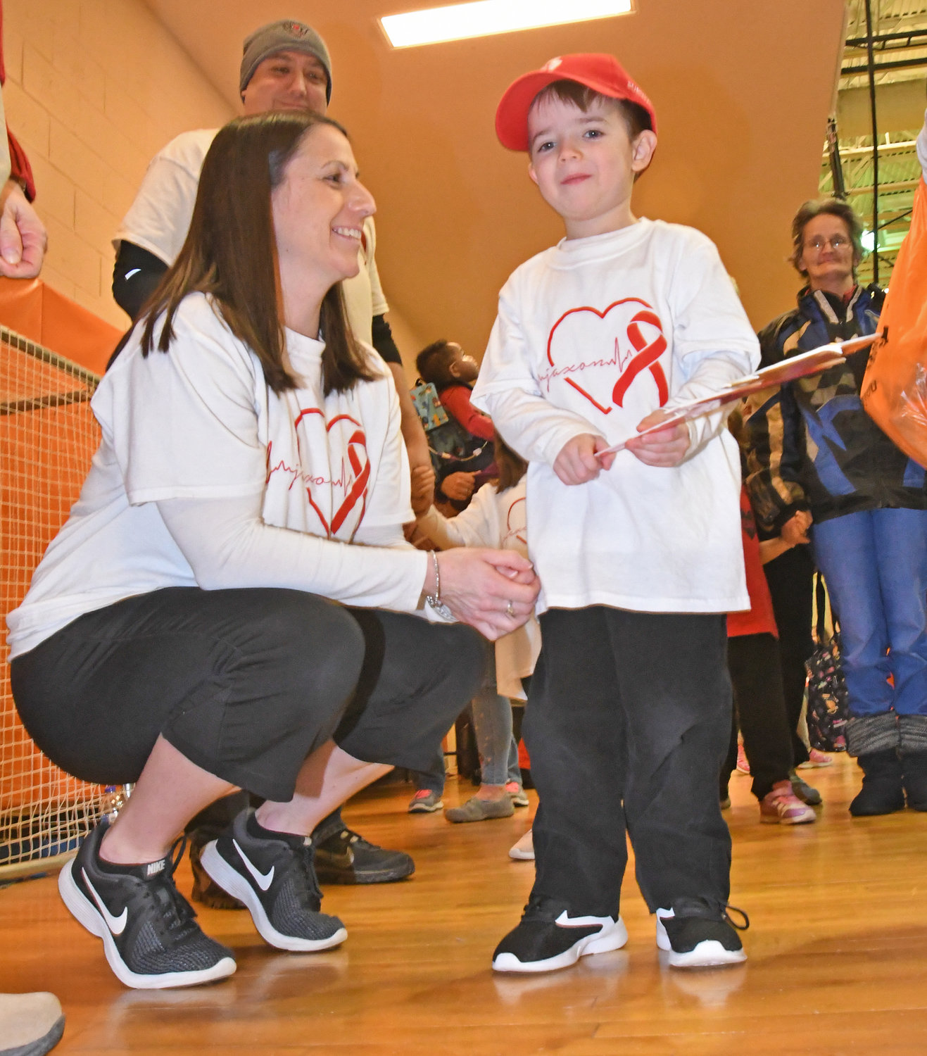 RED CAP AMBASSADOR — Jaxon Hayes, 5, of Rome, with his mom Cindy Hayes and his dad, Patrick, get ready for the start of Saturday's Indoor Heart Run & Walk at Rome Free Academy.