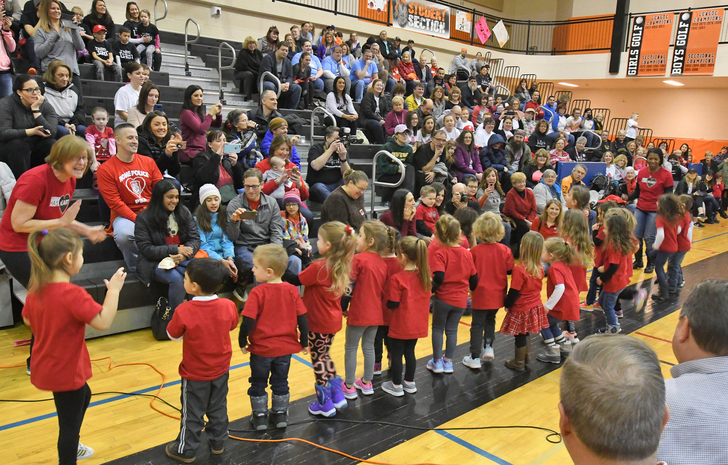 SINGING IN SUPPORT — During the opening ceremony of Saturday's Indoor Heart Run & Walk in the Rome Free Academy gymnasium, a group of classmates of Red Cap Ambassador Jaxon Hayes, sing a song for the walkers.  The event raised more than $17,000 to fight heart disease and stroke.