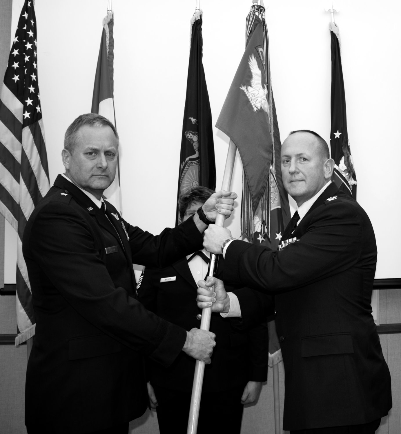 ASSUMING COMMAND — Col. Paul M. Bishop, right, receives the guidon of the 224th Air Defense Group (ADG) from New York Air National Guard commander Brig. Gen. Timothy LaBarge during a change of command ceremony Thursday. The ceremony was at the Rome-based Eastern Air Defense Sector which is associated with the 224th ADG.
