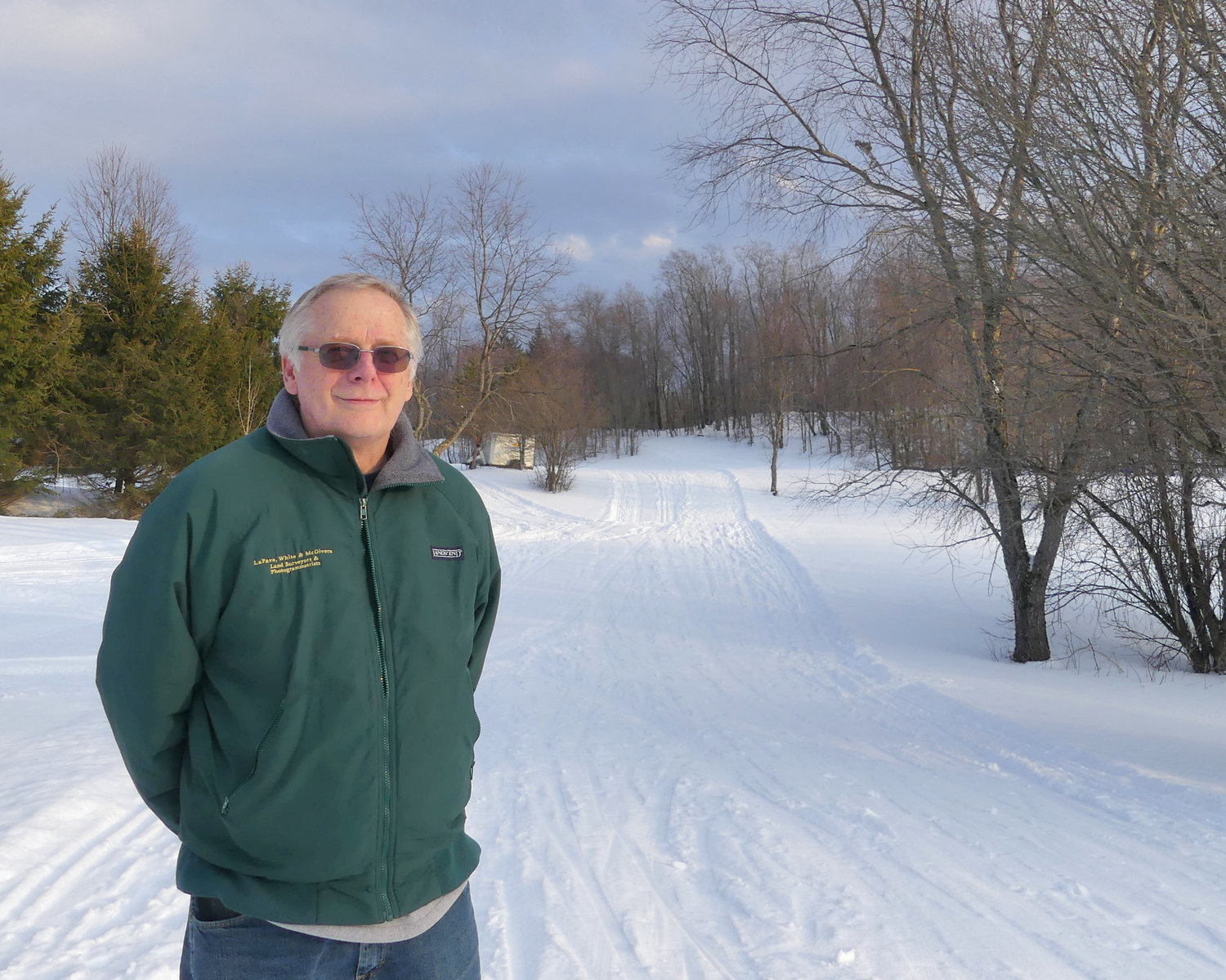 TRAILS FOR SALE — Hugh Quinn poses on a trail near the lodge at Osceola-Tug Hill Cross Country Ski Center. After 39 years, he and his wife, Anna, are putting the center up for sale with plans to retire by by the end of next winter.