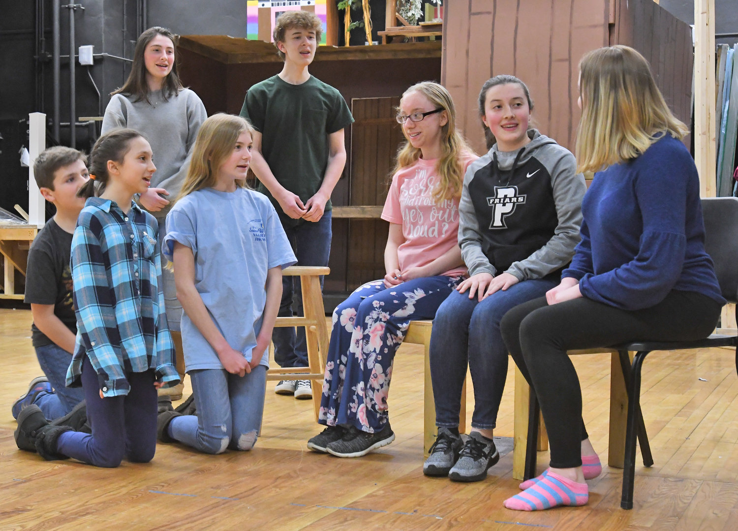 "THE HILLS ARE ALIVE — The VonTrap children with ""Maria,"" played by Meghan Donnelly, practice singing and reciting their lines during rehearsals for The Sound of Music at Westmoreland High School."