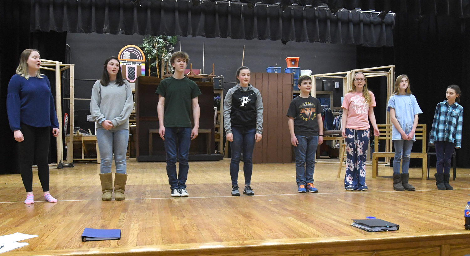 "THE VON TRAPp CHORUS — The Von Trapp children with ""Maria,"" played by Meghan Donnelly, rehearse a song for the upcoming musical, ""The Sound of Music,"" to be performed at Westmoreland High School."